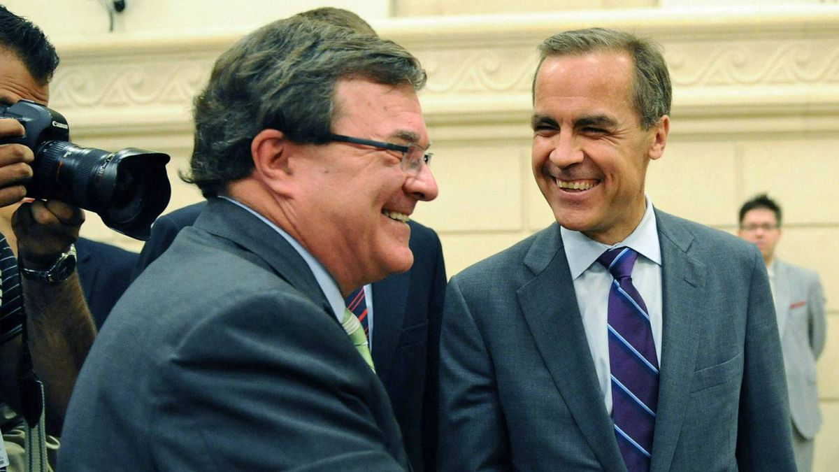 Finance Minister Jim Flaherty and Bank of Canada Governor Mark Carney cross paths as they appear before a Commons committee in Ottawa on Aug. 19, 2011.