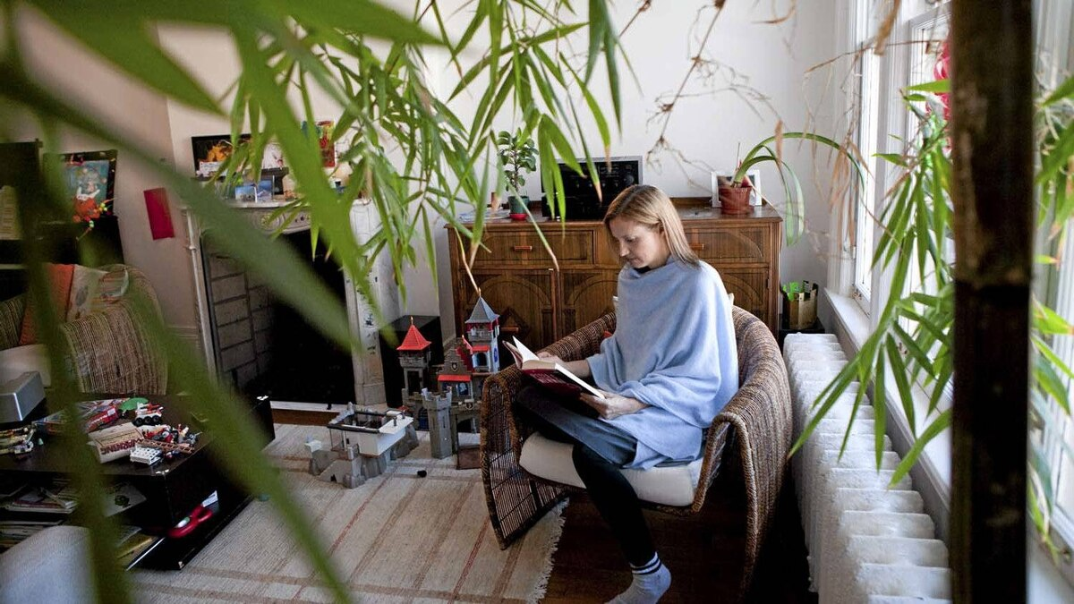 Samantha Nutt, a medical doctor and founder and executive director of War Child, reads in her home in Toronto on Feb. 13, 2012.