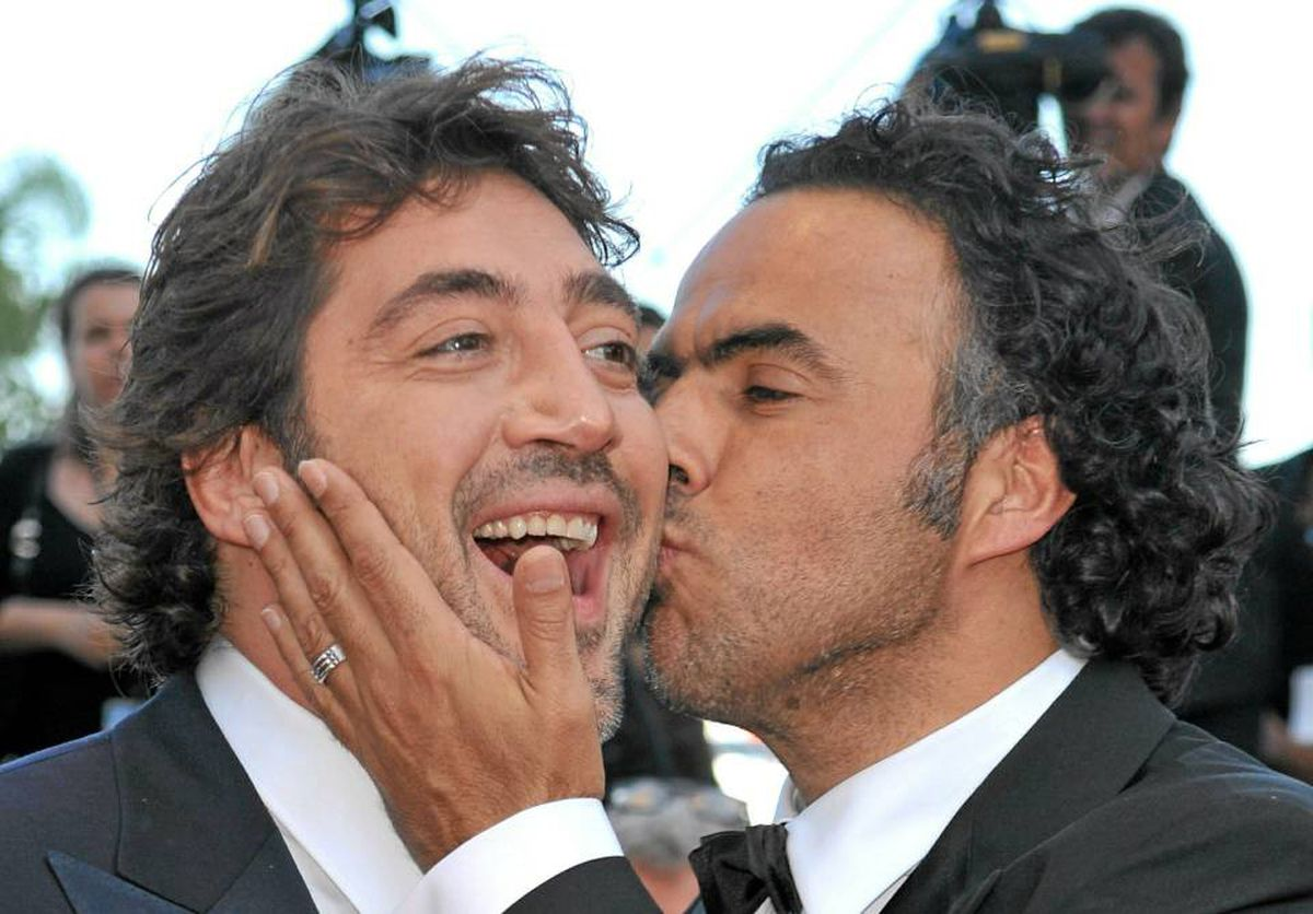 Director Alejandro Gonzalez Inarritu kisses actor Javier Bardem at the premiere of Biutiful, May 17, 2010 in Cannes.