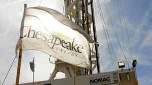 FILE- This Oct. 28, 2009, file photo, shows a Chesapeake drilling rig near Bessie, Okla. (AP Photo/Sue Ogrocki, File)