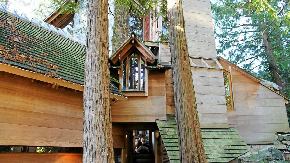 Soaring 50-foot fir trees surround and embrace the home.