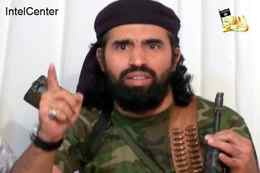 """This video still image released from IntelCenter on December 30, 2009 shows a cropped version of field commander Mohammed al-Awfi as he sits with the senior leadership of al-Qaeda in the Arabian Peninsula (AQAP) when it announced it's new name after merging the regional al-Qaeda arms in Yemen and Saudi Arabia. The 19'00"""" video was released on 23 January 23, 2009 and had a production date of January 15, 2009. It was released by the group's media arm, al-Malahim Media Foundation. The video shows the group's emir Abu Basir Nasir al-Wuhayshi and its deputy leader Saed Abu Sufyan al-Azidi al-Shiri. Also appearing are military commander Abu Hurayrah Qasim al-Reemi and field commander Mohammed al-Awfi. Both al-Shiri and al-Awfi were former GITMO detainees. Al-Wuhayshi escaped from a maximum-security prison in Sanaa, Yemen in 2006 along with 23 others. AFP PHOTO / IntelCenter== RESTRICTED TO EDITORIAL USE / NO SALES / OBSCURING OR CROPPING OUT INTELCENTER LOGO NOT PERMITTED== (Photo credit should read HO/AFP/Getty Images)"""