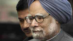 Indian Prime Minister Manmohan Singh arrives on the first day of the winter session of parliament in New Delhi on Nov. 22, 2011.