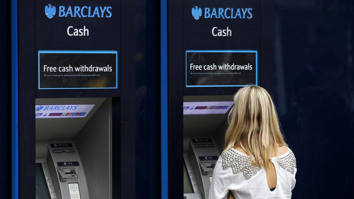 A customer uses a Barclays ATM in central London, July 23, 2010.