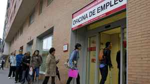 People enter an unemployment office in Madrid Tuesday April 3, 2012. The number of people filing for unemployment benefits in Spain rose by nearly 39,000 last month to a little over 4.75 million.