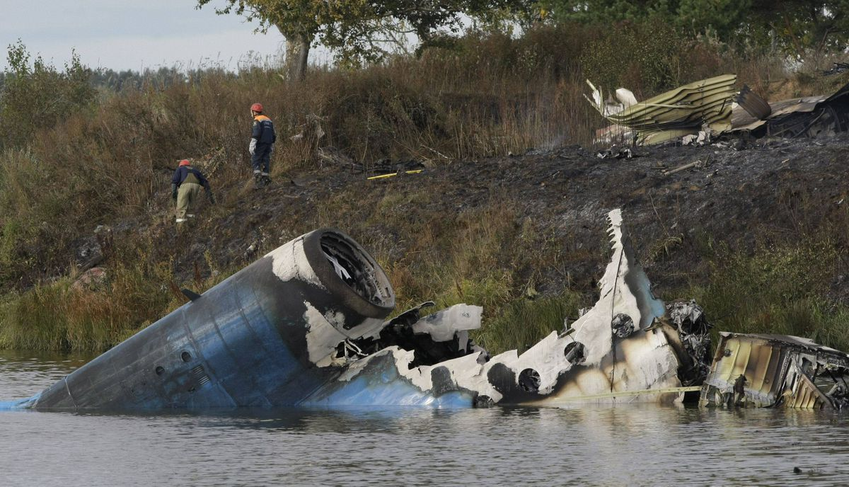 Rescuers seen at the crash site of Russian Yak-42 jet near the city of Yaroslavl, on the Volga River about 150 miles (240 kilometers) northeast of Moscow, Russia, Wednesday, Sept. 7, 2011.