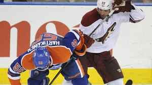 Phoenix Coyotes Michal Rozsival, right, the Edmonton Oilers' Teemu Hartikainen during the second period of NHL hockey in Edmonton on Sunday, March 18, 2012. THE CANADIAN PRESS/John Ulan