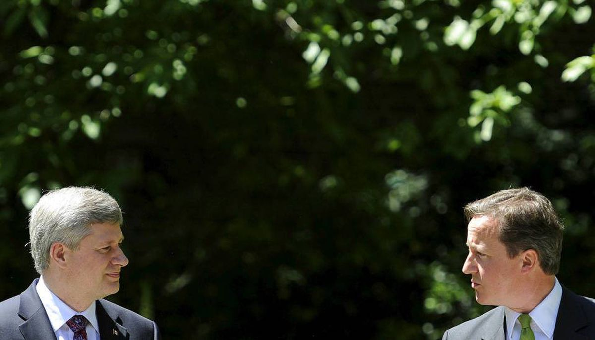 Britain's Prime Minister David Cameron (R), speaks as his Canadian counterpart Stephen Harper, listens during a news conference in the garden of number 10 Downing Street in London June 3, 2010.
