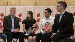 Prime Minister Stephen Harper talks with Conservative candidate for Edmonton - Strathcona Ryan Hastman, far right, and other parents during a roundtable in Beaumont, Alta., on March 28, 2011.
