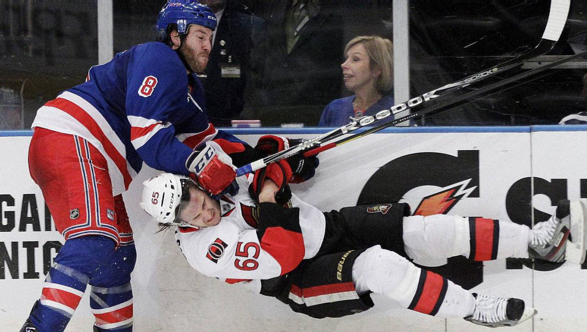 New York Rangers' Brandon Prust (8) and Ottawa Senators' Erik Karlsson (65) collide during the second period of Game 2 of a first-round NHL hockey playoff series Saturday, April 14, 2012, in New York. (AP Photo/Frank Franklin II)