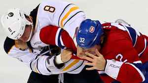 Buffalo Sabres centre Cody McCormick (8) and Montreal Canadiens left wing Travis Moen (32) fight during the second period at the Bell Centre. Jean-Yves Ahern-US PRESSWIRE