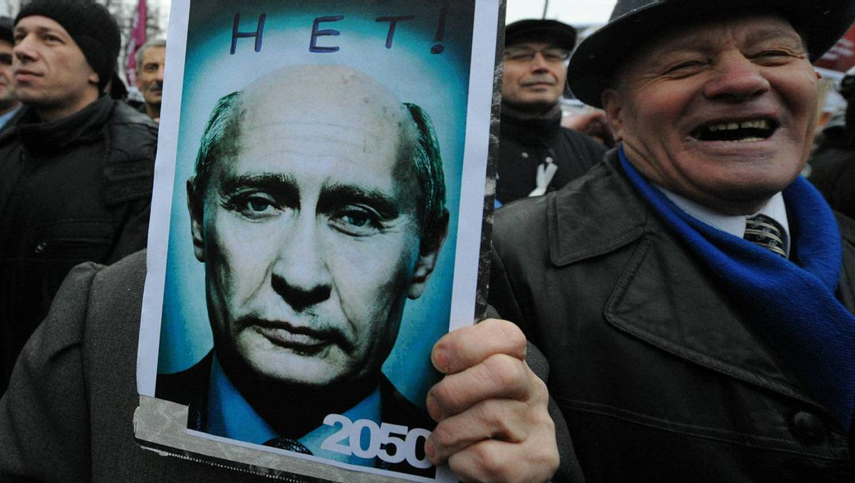 "Opposition activists take part in their authorized rally at the Bolotnaya Square in central Moscow, on December 10, 2011, to protest against the alleging mass fraud in the December 4 parliamentary polls. The poster depicts Russia's Prime Minister Vladimir Putin looking old and reads: ""2050 - No!"" Tens of thousands of election protesters turned out today in Moscow and other major cities across Russia in open defiance to strongman Vladimir Putin's 12-year rule."
