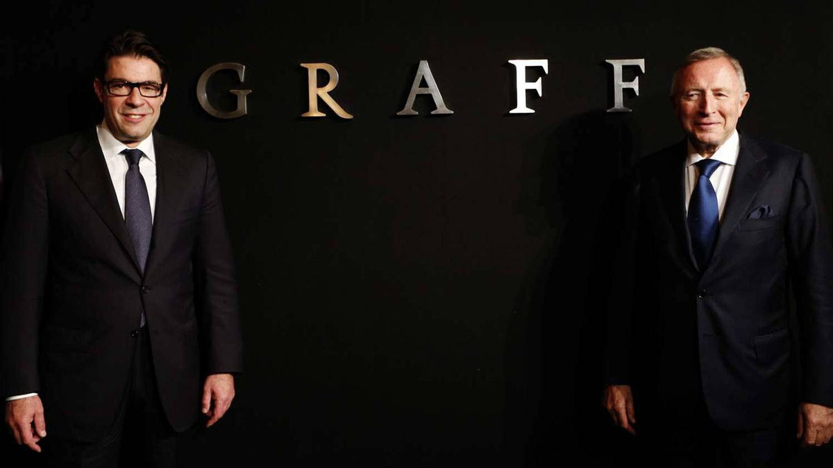 Founder and chairman of Graff Diamonds Laurence Graff, right, and CEO Francois Graff, left, pose before attending the IPO roadshow in Hong Kong on May 21, 2012.