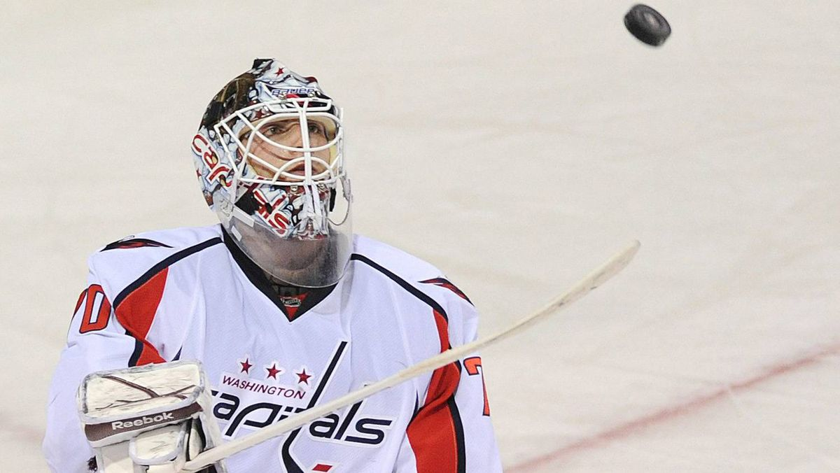 Washington Capitals goaltender Braden Holtby bounces the puck on his stick during third period of an NHL hockey game against the Montreal Canadiens in Montreal, Saturday.