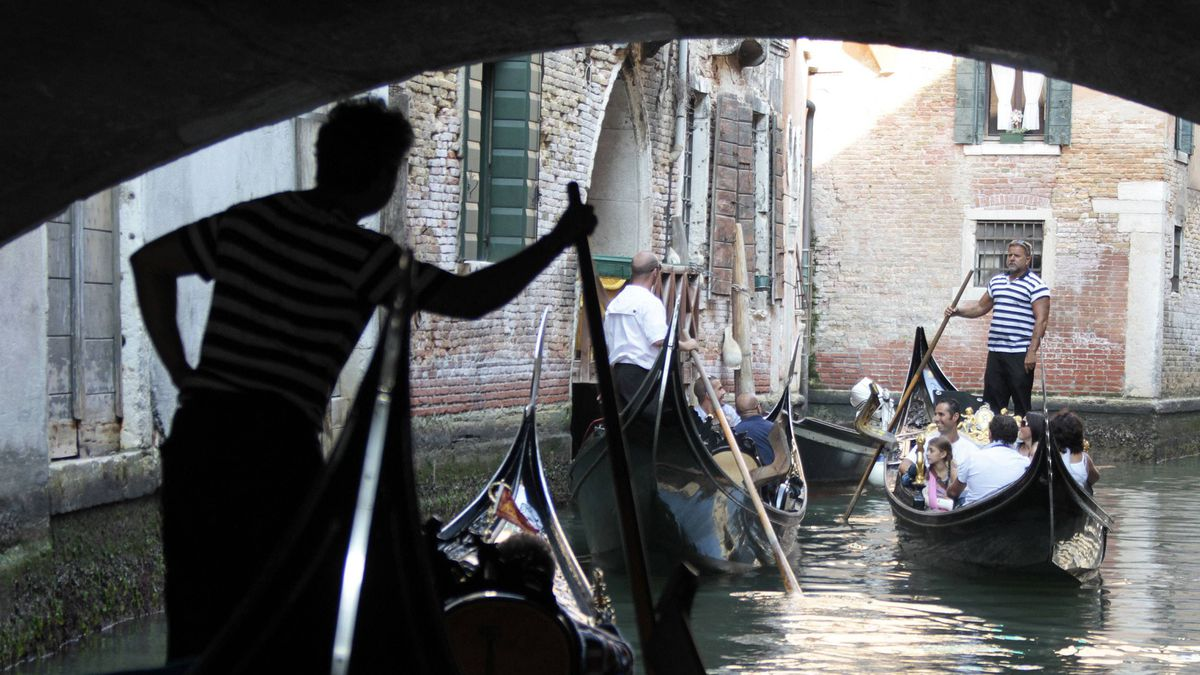 A canal in Venice is clogged with some of tourist-laden gondolas on a recent summer day, September 10, 2011.