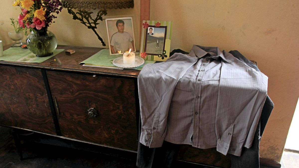 The suit and photos of the David Blancas (who was driver the van) are displayed on a table at her mother's house in Comas .
