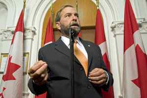 New Democratic Party deputy leader and finance critic Thomas Mulcair speaks to reporters after the NDP's weekly caucus meeting on Sept. 16, 2009, in Ottawa.