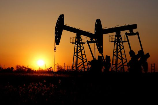Brent crude up near $68 a barrel as supply cuts outweigh economic worry