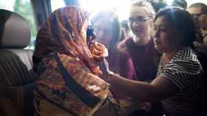 Rumana Monzur, who was attacked and blinded in Dhaka, Bangladesh, by her husband, is comforted by family friend, Monoara Khan (right), outside the Vancouver International Airport in Richmond, British Columbia, Tuesday, July 5, 2011.