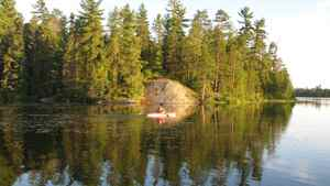 Krista LaRiviere kayaks at her northern Ontario retreat. She paid $300,000 for the island and the 1,000-square-foot log cabin located in a remote bay in the northeast corner of Lake Temagami.