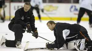 Goaltending coach Francois Allaire talks with goaltender Jean-Sebastien Giguere, then with Anaheim, in 2007