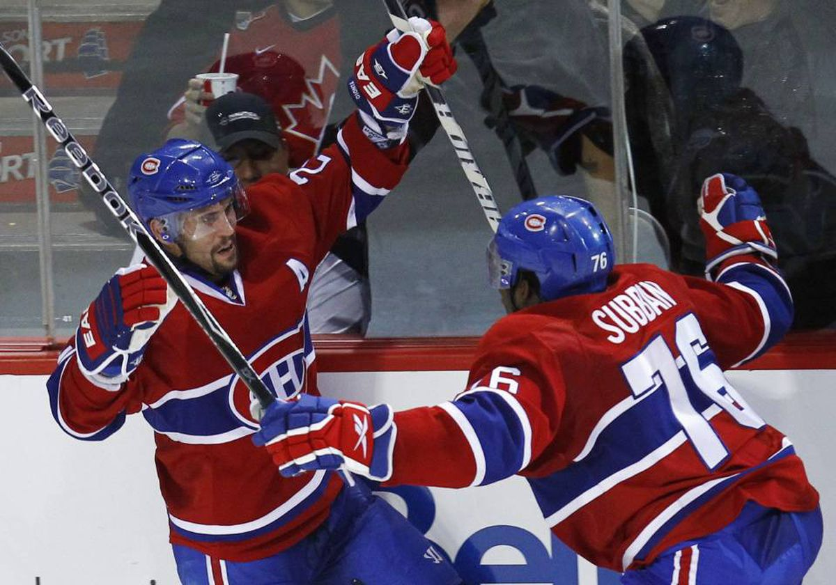 Montreal Canadiens' Brian Gionta (L) celebrates his goal on the Philadelphia Flyers with teammate P.K. Subban during the third period in Game 3 of their NHL Eastern Conference final hockey series in Montreal, May 20, 2010.