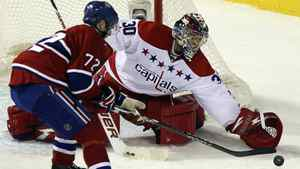 Washington Capitals' goalie Michal Neuvirth (R) makes a save against Montreal Canadiens' Erik Cole during second period NHL hockey action in Montreal January 18, 2012.