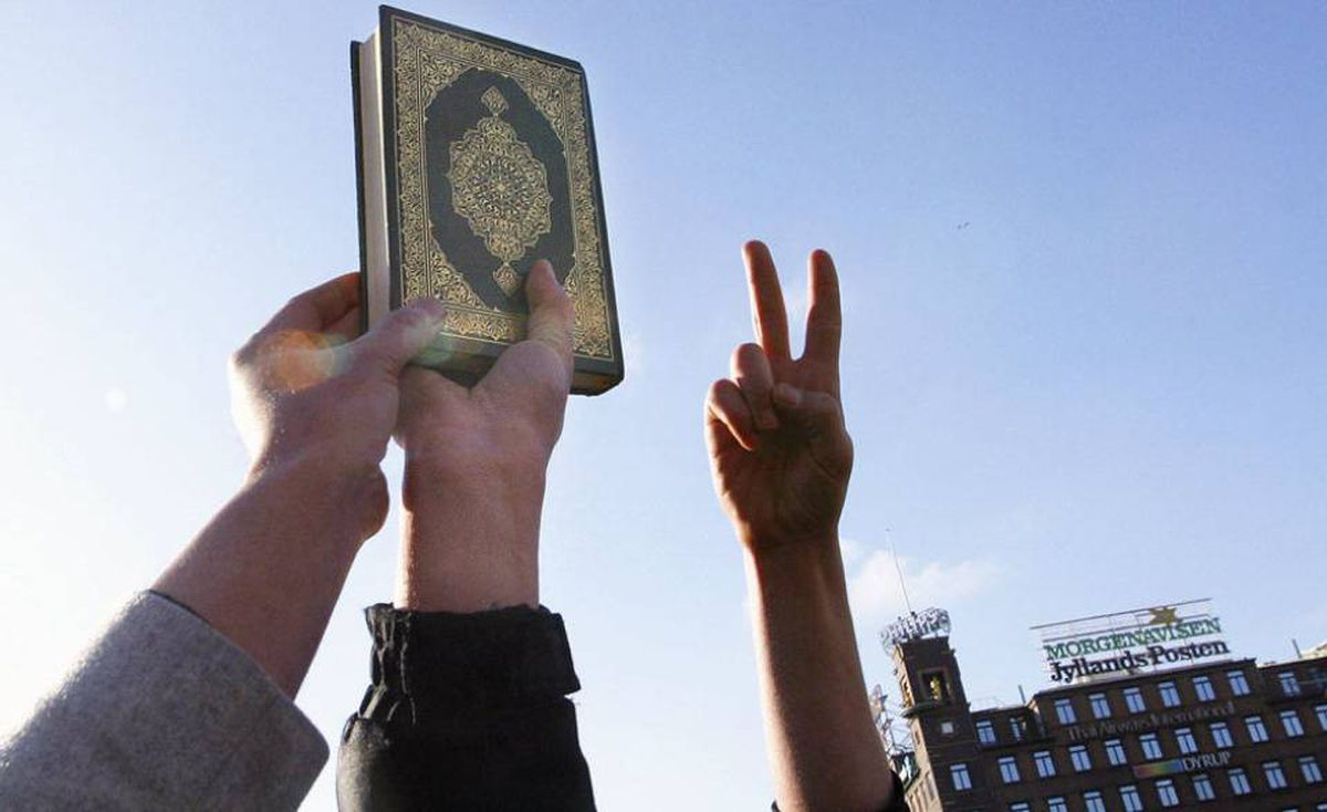 Demonstrators hold a copy of the Koran during a protest in 2006 in front of the Jyllands-Posten newspaper in Copenhagen, which published caricatures of the Prophet Mohammed. David Headly admitted scouting targets for an attack against the newspaper, which was never carried out.