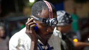 A man tries to talk on his cellphone Jan. 12 in Port-au-Prince, the day a major earthquake rocked Haiti.