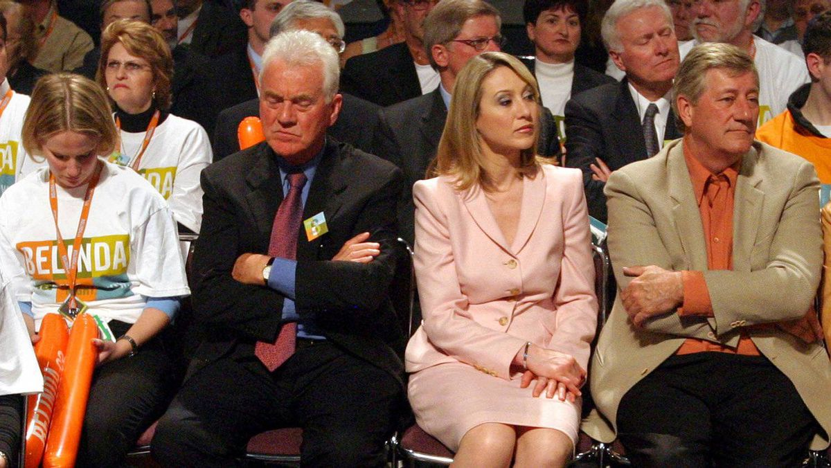 Frank Stronach (left) sits with his daughter Belinda and former Ontario Premier and Magna International board member Mike Harris during the Conservative Party of Canada's 2004 leadership convention. Belinda lost to Stephen Harper.
