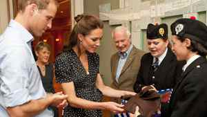 Ottawa bagpiper Madeleine Thompson gives the Duke and Duchess of Cambridge a waistcoat and fascinator adorned with the Maple Leaf tartan during the royal couple's visit to Canada in the summer of 2011.
