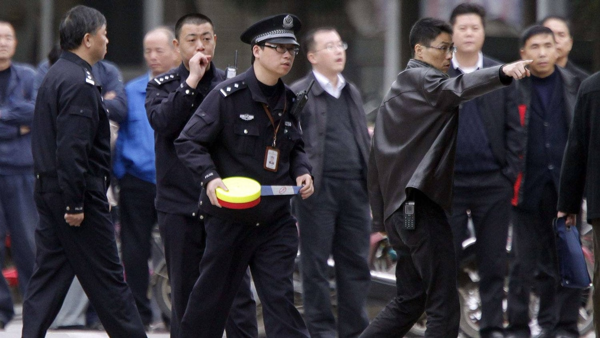 Police arrive at Hi-P International as workers continue their strike in a suburban area of Shanghai. The strike, involving over 200 workers, extended into its seventh day in the latest labour unrest to hit the country.