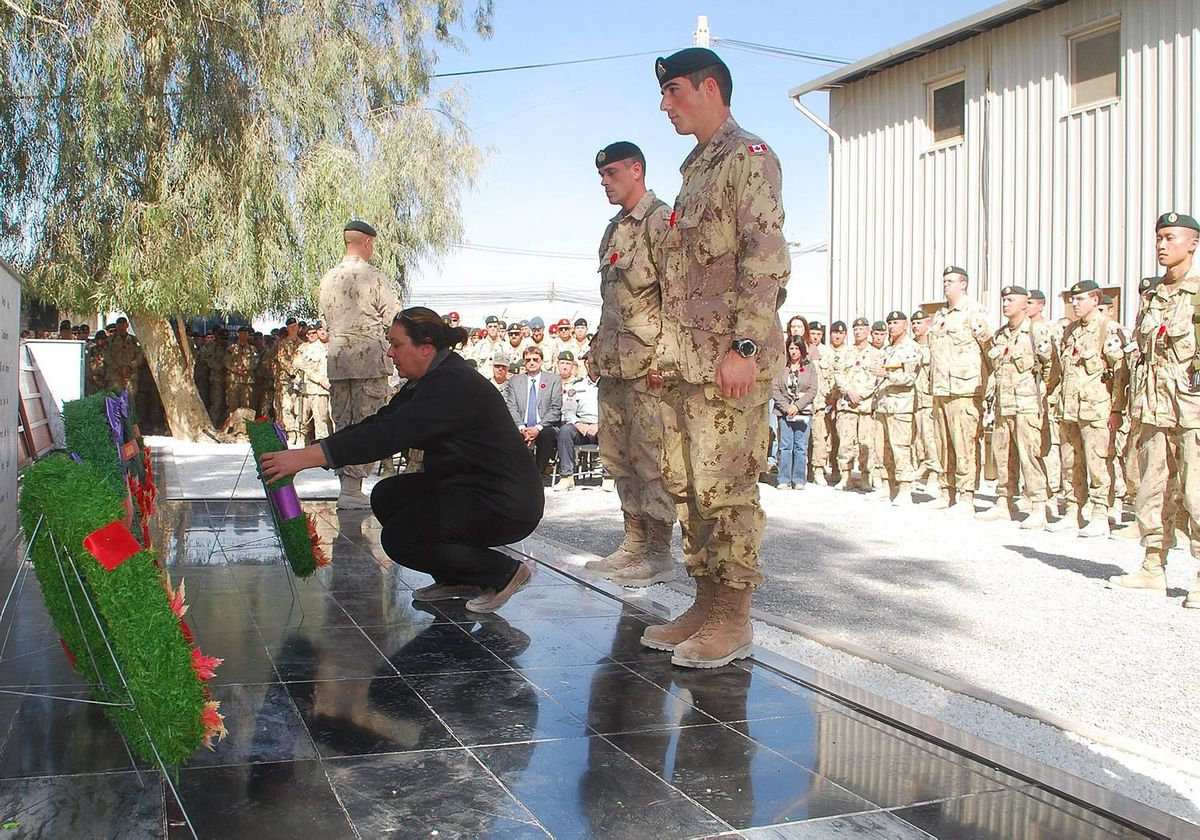 Josee Simard, whose daughter Cpl. Karine Blais was killed in Afghanistan on April 13, 2009, lays a wreath during a Remembrance Day ceremony at Kandahar Airfield, Afghanistan Thursday Nov. 11, 2010. THE CANADIAN PRESS/ Jonathan Montpetit