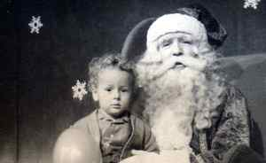 """Ron Russell writes: """"This is a picture of me (I'm the one on the left) with Santa taken in 1948. I still have those curls and Santa hasn't changed much either."""""""