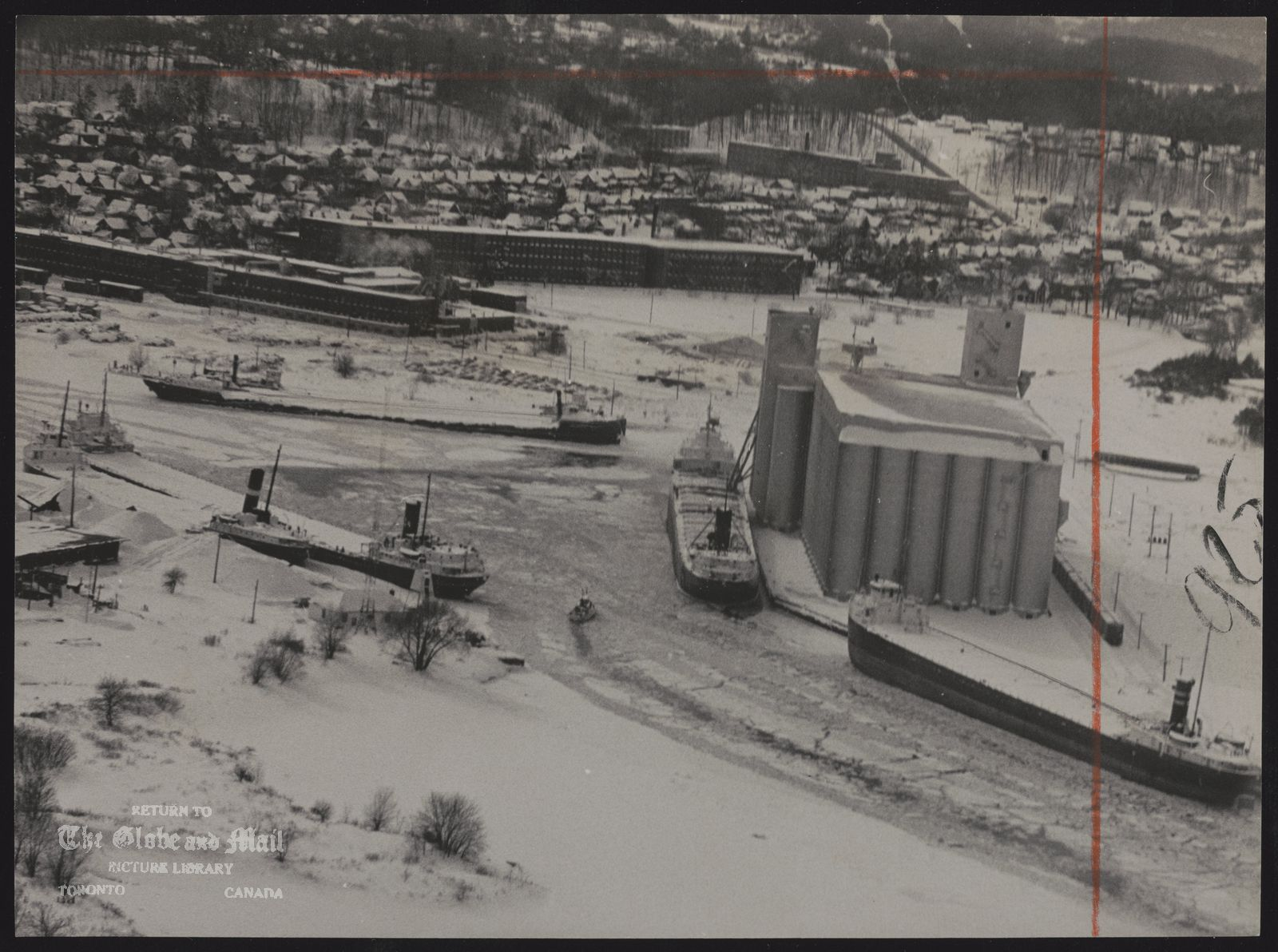 The notes transcribed from the back of this photograph are as follows: Tugboat churns through ice to keep channel open around elevator at Owen Sound harbor. More than 30 inches of snow have fallen in area since Saturday, but yesterday many concession roads were opened.
