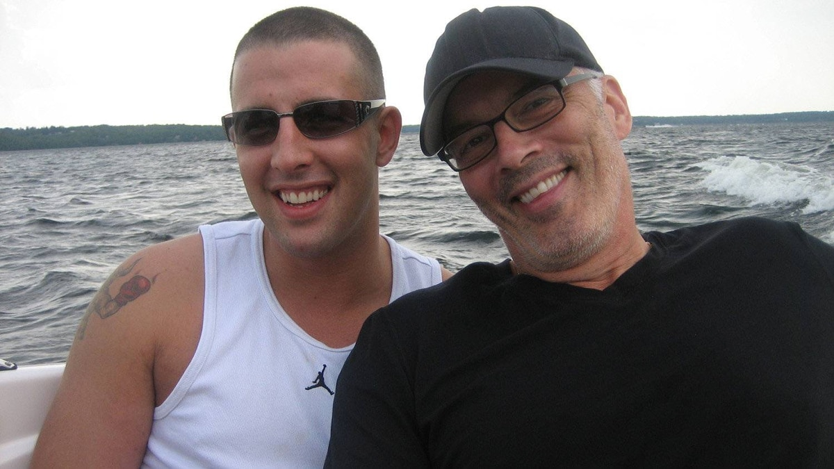 CBC sports reporter Scott Oake poses with his son Bruce, who died of a drug overdose in March, 2011.