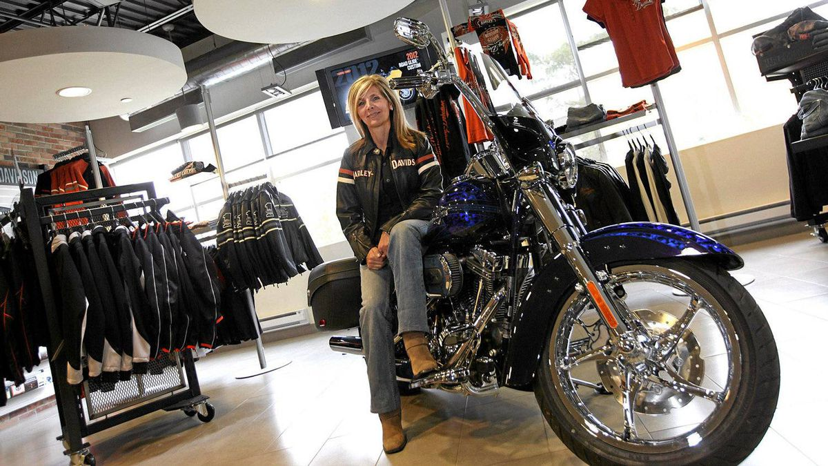 Concord, 28/09/11 - Mary Testani, Senior Manager, Business Systems with Deeley, Harley-Davidson Canada, poses for a photo on one of the motorcycles in the office showroom in Concord, Ont.