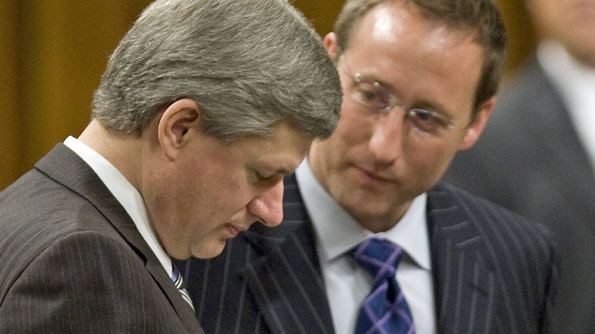 Prime Minister Stephen Harper goes over documents with Defence minister Peter MacKay in the House of Commonson Nov. 18, 2008.