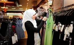 Sarah takes a closer look at the dress while shopping with her mother at a Mississauga mall.