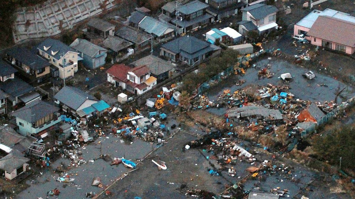 An aerial view shows debris that remained on the ground after a tsunami wave to hit Hitachinaka city in Ibaraki prefecture.
