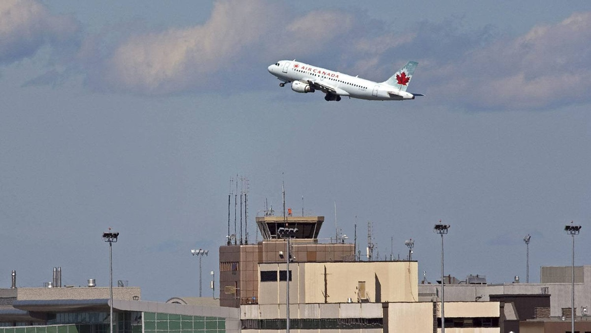 An Air Canada jet takes off over the terminal at the Halifax airport . Flight attendants are poised to go on strike at 12:01 a.m. on Wednesday.