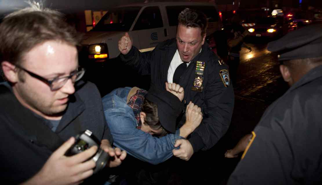 An Occupy Wall Street protestor draws contact from a police officer near Zuccotti Park after being ordered to leave the longtime encampment in New York, Tuesday, Nov. 15, 2011, in New York, after police ordered demonstrators to leave their encampment in Zuccotti Park.