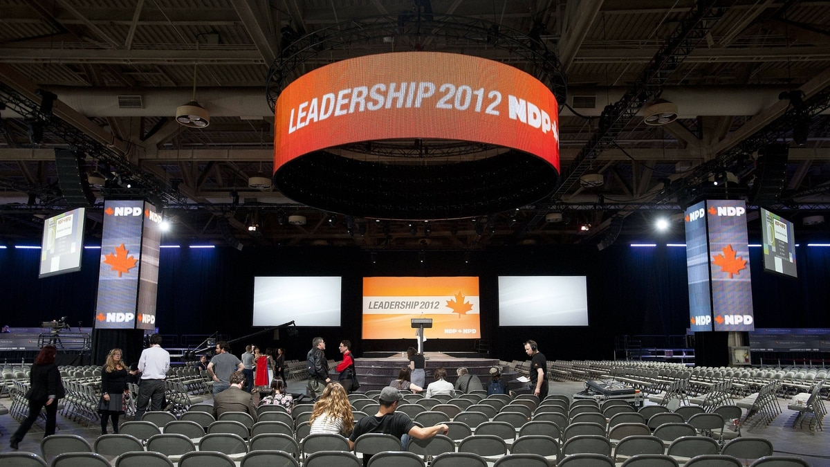 Workers prepare for the NDP leadership convention at the Metro Toronto Convention Centre in Toronto, Ont. March 22, 2012.