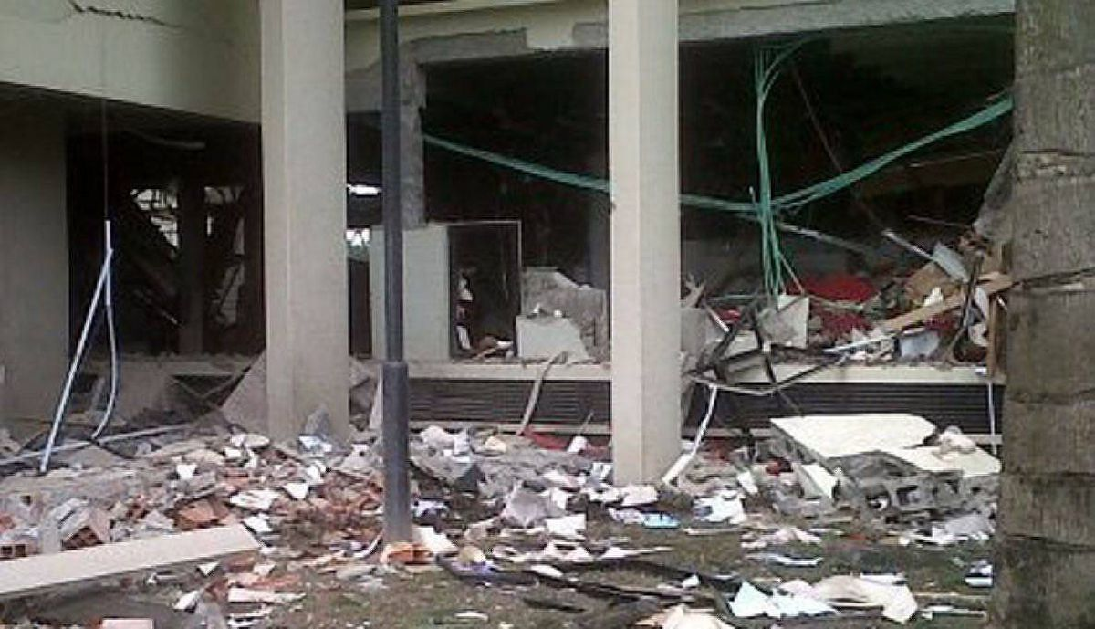 This image released by Saharareporters shows debris after a large explosion struck the United Nations' main office in Nigeria's capital Abuja Friday Aug. 26, 2011, flattening one wing of the building and killing several people.