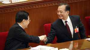 Chinese Premier Wen Jiabao, right, is greeted by Chinese President Hu Jintao after his speech during the opening session of the National People's Congress in Beijing's Great Hall of the People, China, Monday, March 5, 2012.