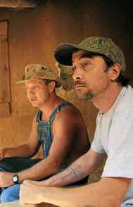 """REALITY Moonshiners Discovery, 9 p.m. ET; 11 p.m. PT Currently one of the most-watched programs on the U.S. Discovery Channel, and pulling solid ratings here, this series surely gives hope to anyone wanting to make a living from illegal activity. As the title suggests, the premise follows a group of country boys brewing up homemade liquor deep in the hills of rural Virginia. One camera crew follows the veteran moonshiner Tim, his son JT and their partner in crime known as """"Tickle."""" The other unit tracks the government agent Jesse, whose job is to bring down the good ol' boys. It's fascinating and seemingly unfaked and you have to admire that get-'er-done moonshiner mentality. In tonight's new episode, Tim and Tickle soup up the hot rod they use to make deliveries, but only because they're forced to make a daring daytime bootlegging run."""