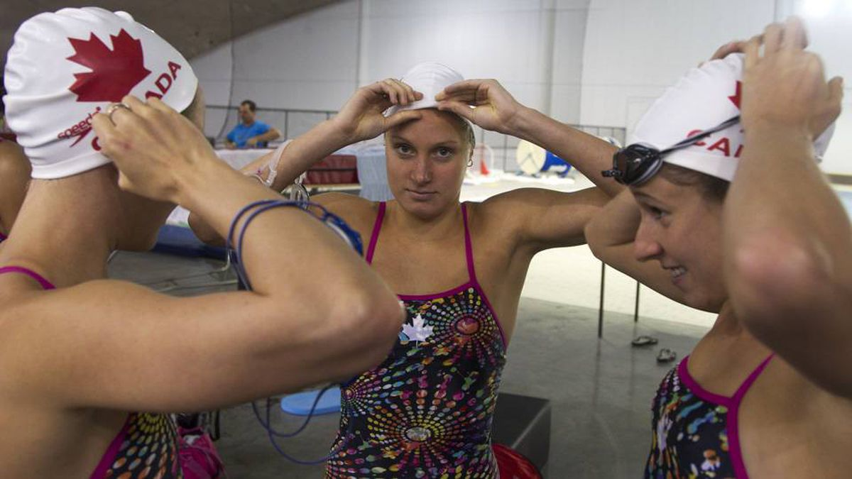 Canada's Olympic synchronized swimmers gear up for practice at the Olympic Pool in Montreal. The training day typically starts early at 6:00 a.m., and they train until late afternoon six days a week.