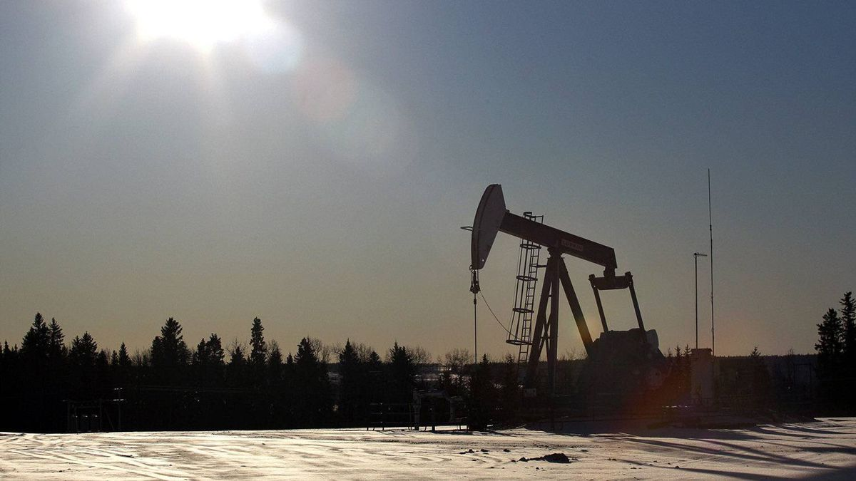 A pump jack draws oil from the ground at a hydraulic fracturing operation near Bowden, Alta.