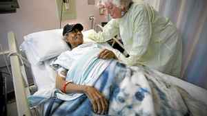 Edward Gamblin and Florence Kaefer share a moment in Mr. Gamblin's hospital room in Winnipeg on Thursday.