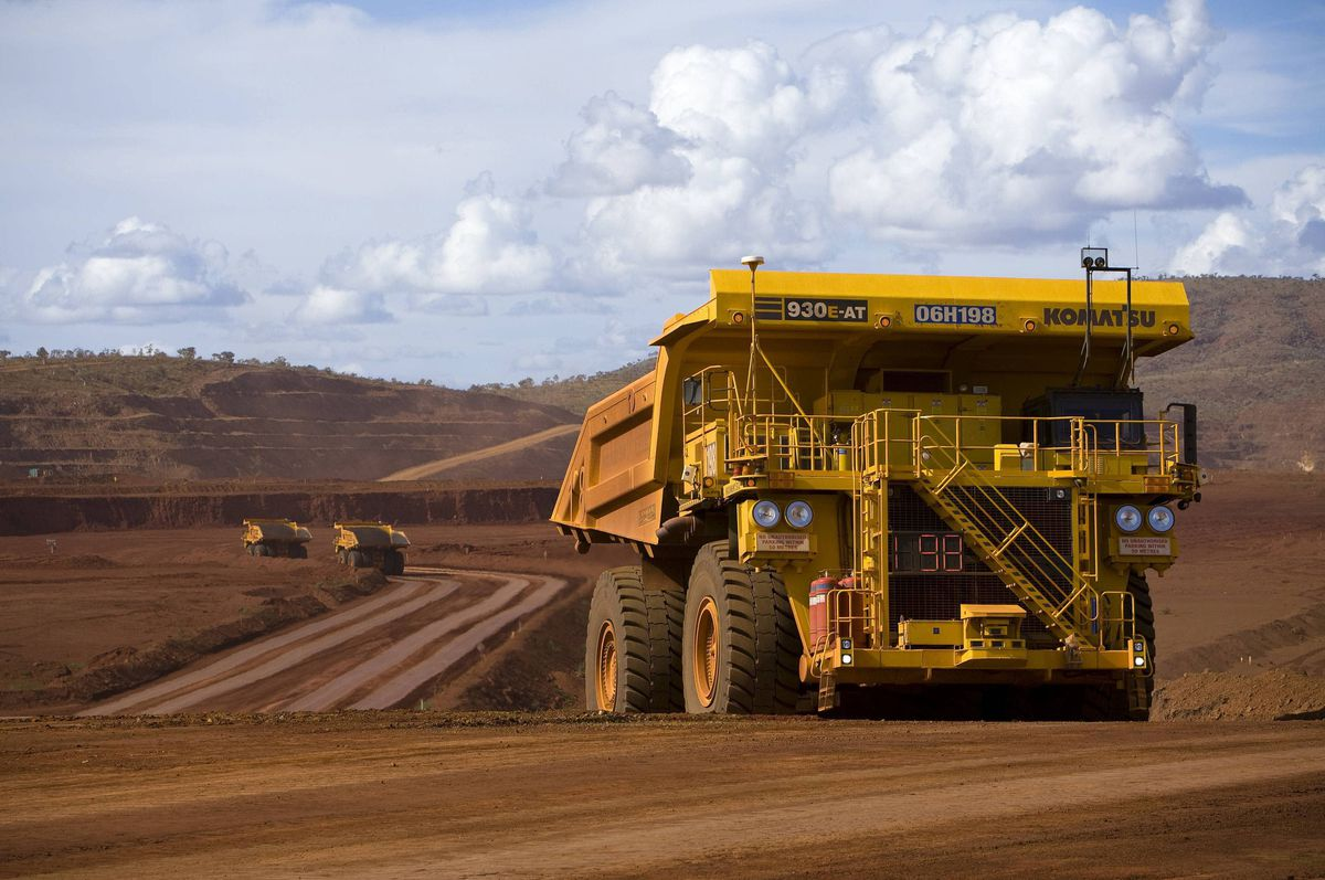 Remotely controlled tipper trucks operate at a Rio Tinto iron ore mine in Western Australia in this file undated picture made available March 26, 2012.